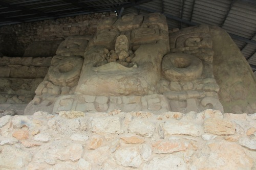 Huge stucco masks atop the pyramid in Acanceh, Yucatan; Photo:KFawcett